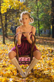 Autumn portrait of young pretty woman on a vintage Royalty Free Stock Image