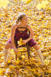 Autumn portrait of young pretty woman on a vintage Royalty Free Stock Photos