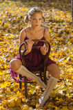 Autumn portrait of young pretty woman on a vintage Royalty Free Stock Photo