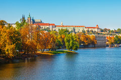 Autumn Prague castle over river Vltava Stock Photos
