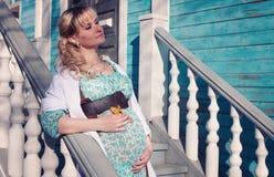 Autumn pregnant woman outdoors Royalty Free Stock Photo