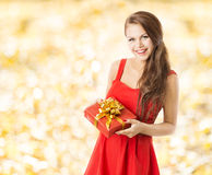 Autumn present gift box, smiling woman holding pre stock images