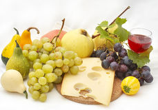 Autumn products. Glass white and red wine with autumn fruits Stock Image