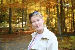 Autumn promenade. Happy woman in sunny autumn forest, Bavaria Germany Royalty Free Stock Photo