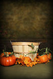 Autumn Pumpkin Basket. Fruit Basket adorned with fall leaves, can be used as a digital photography prop. with added pumpkins royalty free stock image