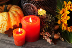 Autumn pumpkin decor. Autumn thanksgiving decor with pumpkin candle and sunflower Royalty Free Stock Image