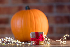 Pumpkin with Fairy Lights at Halloween holiday Stock Photos