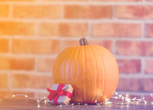 Pumpkin with Fairy Lights at Halloween holiday Stock Photography