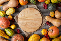 Autumn pumpkin harvest decoration frame empty blank space for design text with cutting board Royalty Free Stock Image
