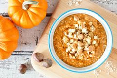 Autumn pumpkin oatmeal overhead table scene Stock Image