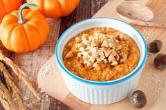 Autumn pumpkin oatmeal with walnuts, chocolate and peanut butter chips Royalty Free Stock Image