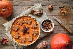 Pumpkin pie with pecan nuts on wooden background Stock Photo