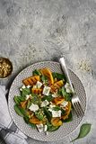 Autumn pumpkin salad with spinach, feta cheese and walnuts.Top royalty free stock images