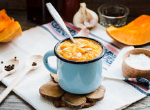 Autumn pumpkin soup in a blue mug, rustic background. Healthy food Royalty Free Stock Photo