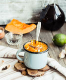 Autumn pumpkin soup in a blue mug, rustic background. Healthy food,selective focus Stock Image
