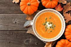 Autumn pumpkin soup, rustic overhead scene on wood Royalty Free Stock Images