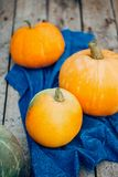 Autumn Pumpkin Thanksgiving Background - orange pumpkins over wooden table royalty free stock photography