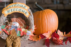 Autumn pumpkin welcome. A decorative display of an autumn welcome and pumpkins Royalty Free Stock Photo