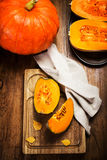 Autumn pumpkin on wooden table with yellow leaves. Beautiful aut Royalty Free Stock Images