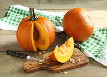 Autumn pumpkins. On a table Royalty Free Stock Photo