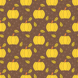 Autumn pumpkins and leaves pattern stock photography