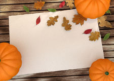 Autumn pumpkins with leaves on wooden board Stock Photo