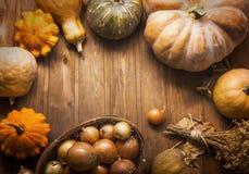 Autumn pumpkins and other fruits and vegetables on wooden thanks. Autumn pumpkins and other fruits and vegetables on a wooden thanksgiving table stock photos