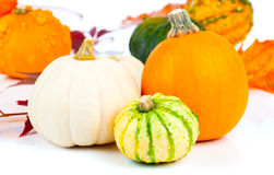 Autumn pumpkins in a straw basket Stock Photo
