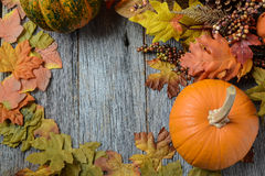 Autumn pumpkins surrounded by leaves Stock Photo