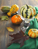 Autumn pumpkins and vaple leaves. On wooden table Royalty Free Stock Images