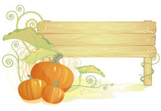 Autumn pumpkins with wooden sign Stock Photos