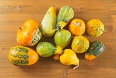 Autumn pumpkins on wooden table Stock Photography