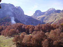 Autumn in the Pyrenees. On our walk in the mountains of the pyrenees we suddenly saw stripe of smoke thinking that it was a fire somewhere but turned out to be Stock Photography