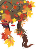 Autumn queen. Stylized woman image with  autumn leafs, berries and birds Royalty Free Stock Images