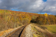 Autumn railway. Beautiful railway track in deep forests during autumn color stock images