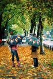 Autumn rain. Two girls standing on the rain Royalty Free Stock Photos