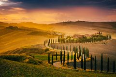 Autumn rain in beautiful tuscany. Tuscany, Italy - September 27, 2017: Beautiful Tuscany at sunset after rain. Autumn in Crete Senesi with cypress trees. Italy stock image