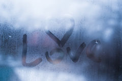 Autumn rain, the inscription on the sweaty glass - love and heart Stock Photo