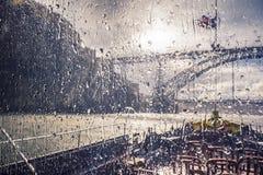 Autumn rain during river excursion, Porto. Autumn rain during river excursion, view at Dom Luis Bridge, Porto stock photo