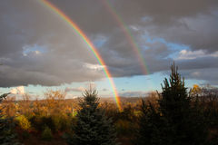 Autumn Rainbow. A beautiful double rainbow, photographed during the autumn as a storm leaves the area royalty free stock photos