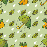 Autumn rainy pattern with umbrellas, socks, leaves and drops. Stock Photos