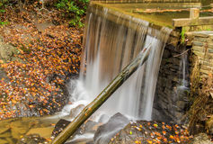 Autumn at Rakes Mill Pond Dam. And waterfall located on the Blue Ridge Parkway in Floyd County, Virginia, USA Stock Images