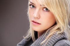 Autumn Ready Blond Beauty. Closeup Of A Beautiful Blond Woman Wearing A Big Collar Sweater Royalty Free Stock Images