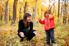 Autumn is a real fun!. Mother and daughter smiling playing together in the park Stock Photo