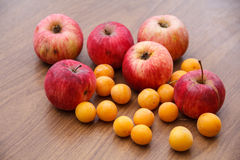 Autumn. Red apples fall to the ground. Royalty Free Stock Image