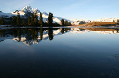 Autumn Reflection. A reflection of Mount Garibaldi off of Elfin Lake stock photo