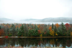 Autumn reflections. On a October day in the White Mountains the snow enhanced the bright colors of the autumn trees stock photos