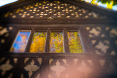 Autumn reflections in old house windows royalty free stock photography