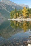 Autumn reflections, trees, Lake McDonald, Royalty Free Stock Photography