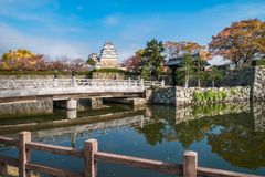 Autumn reflections in water at the gate to Himeji Castle in Japan. Sakuramon-bashi bridge over the inner moat at the entry gate of Himeji Castle also called ` stock images